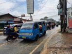 Kemacetan-parah-terjadi-di-Jalan-Raya-Sawangan-pada-Kamis-2392021-siang.jpg