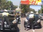viral-polisi-yang-terseret-di-kap-mobil.jpg