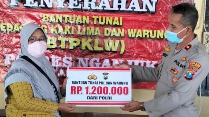 Polres Nganjuk Salurkan Bantuan Tunai Rp 1,2 Juta Dari Pemerintah Pusat Untuk 350 PKL