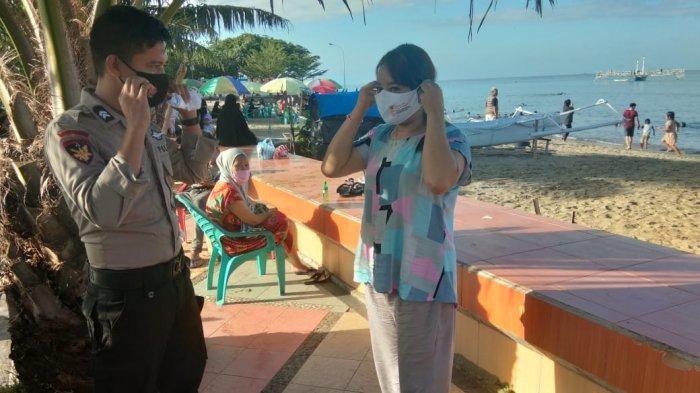 Polisi Razia Warga Tak Pakai Masker di Pantai Bahari Polewali