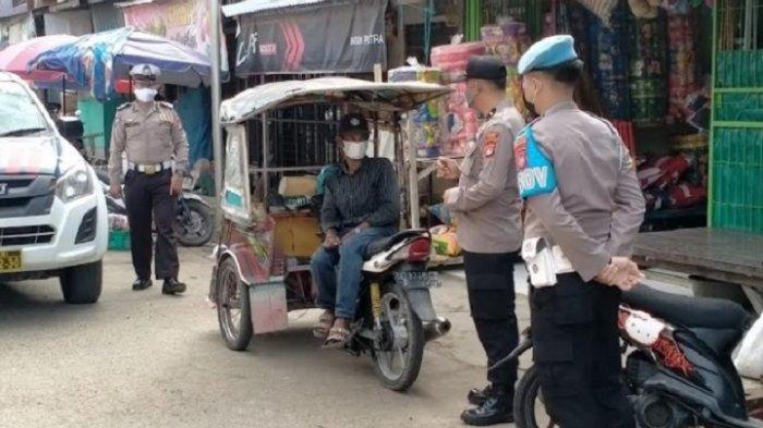 Polres Polman Razia Warga Tak Pakai Masker di Pasar