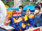 Bupati-Mamuju-Sutinah-Suhardi-salurkan-bantuan-kepada-warga-terdampak-banjir.jpg