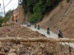 Kondisi-Jalur-Trans-Sulawesi-di-Lombona-Desa-Tubo-Tengah.jpg