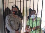 Oknum-Anggota-DPRD-Mamasa-saat-berada-di-tahanan-Polda-Sulbar.jpg
