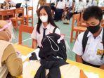 Pelaksanaan-vaksinasi-massal-Binda-Sulbar-di-SMPN-2-Mamuju-Selasa-12102021.jpg