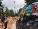 Personil-Polres-Majene-saat-mengatur-lalu-lintas-di-Jalur-Trans-Sulawesi.jpg