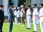 Presiden-Joko-Widodo-Saat-mengukuhkan-anggota-Paskibraka-di-Istana-Negara.jpg