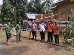 Tim-BPBD-TNI-dan-Kepolisian-memantau-lokasi-banjir-di-Desa-Rappang-Tapango.jpg
