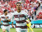 ekspresi-Cristiano-Ronaldo-usai-cetak-gol-ke-gawang-Hungaria.jpg