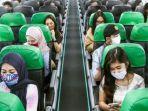 pemakaian-masker-dalam-pesawat.jpg