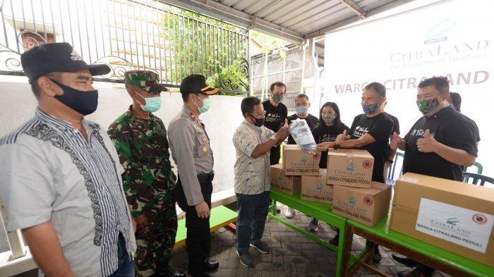 City Management CitraLand Bagikan Ribuan Sembako dan APD Pada Warga Sekitar