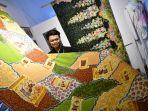 mahasiswa-unesa-rendra-aditya-putra-adam-refleksikan-sejarah-surabaya-lewat-batik.jpg