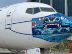 Pesawat-Garuda-Indonesia-menggunakan-masker-berciri-Barong-Bali.jpg