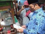 Wali-Kota-Tangerang-Arief-Wismansyah-saat-melakukan-sidak-terhadap-pedagang.jpg