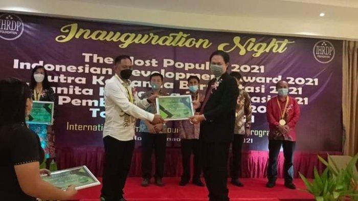 Persembahkan Bagi Warga Desa Torosik, Mohammad Bakri Mokoagow Berhasil Sabet Pembangunan Award 2021