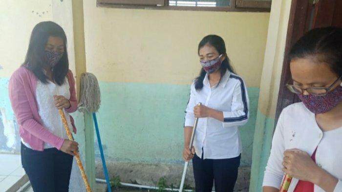Intip Keunikan Masker Motif Batak sebagai Pencegah Virus Corona - warga-desa-lumban-suhi-suhi-memakai-masaker-motif-batak.jpg