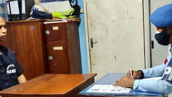 Salah satu anggota POM Lanud Yohanes Abraham Dimara Merauke, tengah menjalani pemeriksaan setelah melakukan aksi kekerasan kepada seorang pemuda, Steven, Papua, Selasa (26/7/2021).