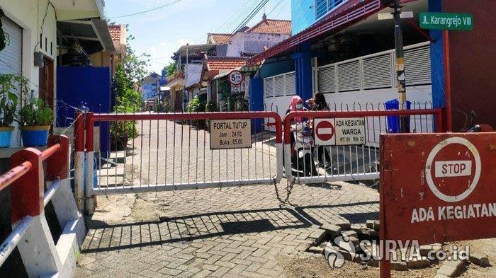 penutupan-akses-masuk-wilayah-kampung-bagi-warga-di-karangrejo.jpg