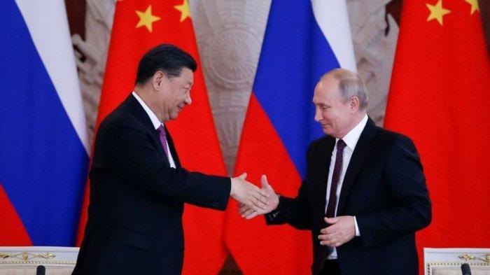 Presiden China, Xi Jinping dan Presiden Rusia, Vladimir Putin.