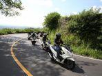 Simak Tips Tetap Aman Bepergian Jauh dengan Sepeda Motor