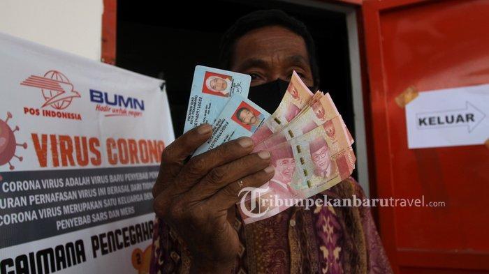 FOTO : Pengambilan Bantuan Sosial Tunai Rp 600 ribu di Kantor Pos Pekanbaru - bantuan-sosial-tunai1.jpg