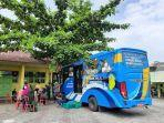 Bus-vaksinasi-keliling-saat-melayani-masyarakat-di-Kota-Pekanbaru-beberapa-waktu-lalu.jpg