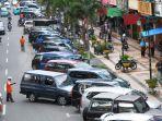 sejumlah-kendaraan-parkir-di-jalan-sudirman-pekanbaru-beberapa-waktu-lalu.jpg