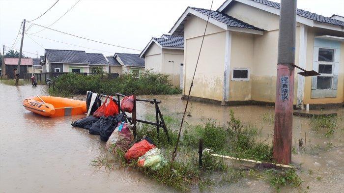 Foto: Banjir di Perumahan Pesona Harapan Indah Kota Pekanbaru - Banjir-di-Perumahan-Pesona-Harapan-Indah-Jalan-Cengkeh-Kota-Pekanbaru-mulai-surut.jpg