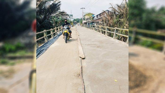 Jembatan menjadi lebih baik setelah lubang di cor dan dilakukan perbaikan secara swadaya oleh masyarakat