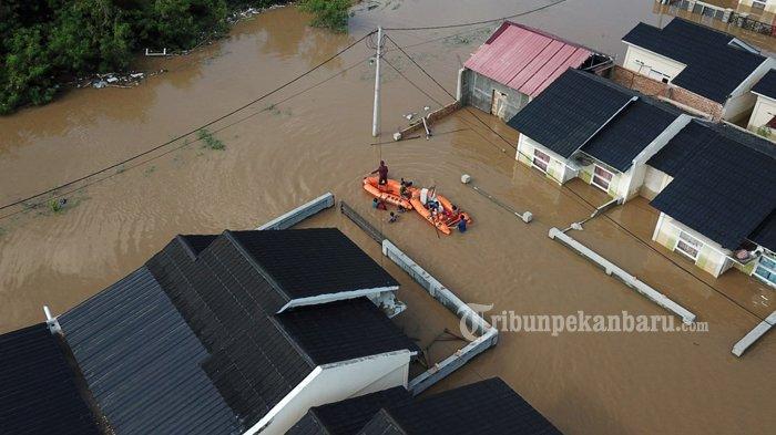 Foto: Banjir di Perumahan Pesona Harapan Indah Kota Pekanbaru - Perumahan-Pesona-Harapan-Indah-salah-satu-perumahan-yang-terdampak-banjir-di-Kota-Pekanbaru.jpg
