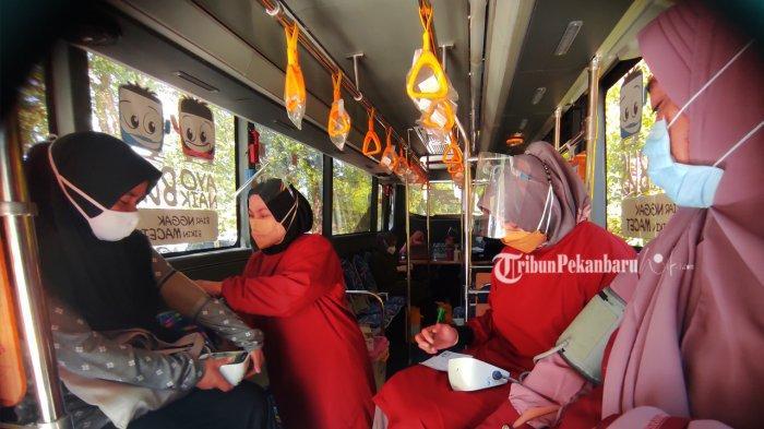 Vaksinasi Covid-19 Sambil Berwisata di Taman Rekreasi Alam Mayang Pekanbaru