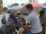 Alumni-Dikmaba-Polda-Riau-Bagikan-Paket-Sembako-Untuk-Masyarakat.jpg