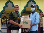 Badan-Wakaf-Al-Quran-BWA-mendistribusikan-Al-Quran-di-Kepulauan-Meranti.jpg