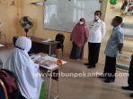 Walikota-Pekanbaru-saat-meninjau-belajar-tatap-muka-di-SMP-Madani-Pekanbaru-Rabu-15-September-2021.jpg