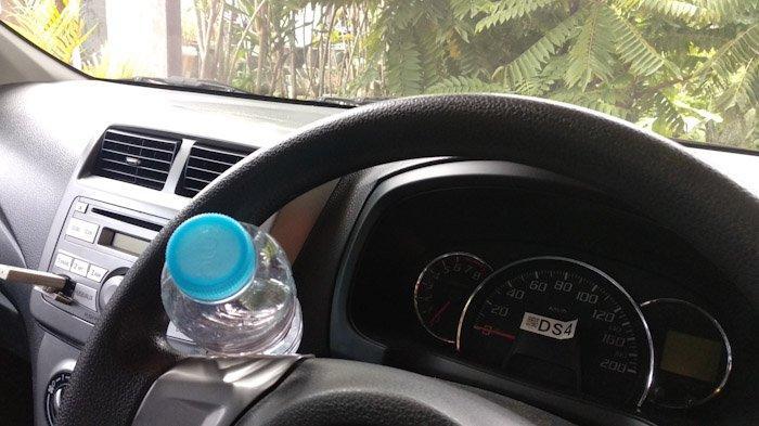 Bahaya Meninggalkan Botol Minuman Plastik di Kabin Mobil