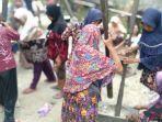 Budaya Ngamping Menumbuk Amping Gotong Royong, Biasa Dilakukan Saat Panen 'Beranyi' Pertama