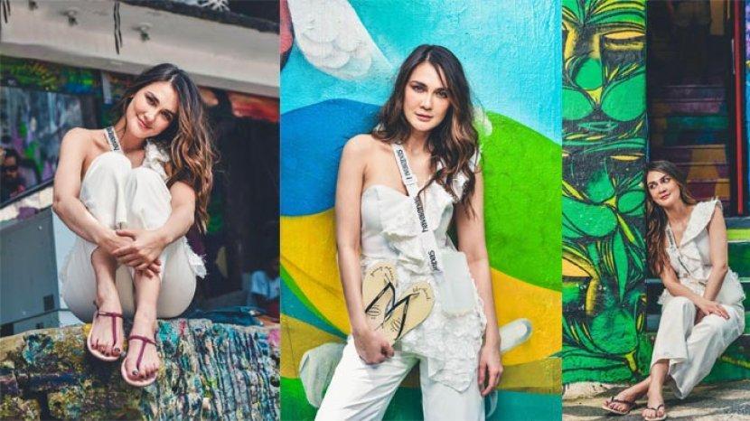 Inspirasi Fashion Liburan dari Luna Maya, Padu pada Jumpsuit Chic dengan Sandal Jepit